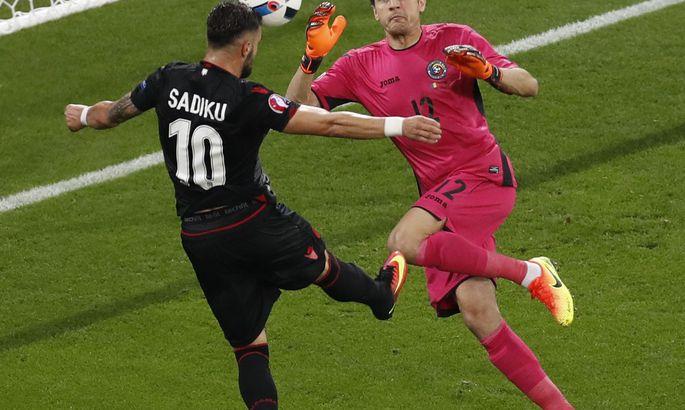 aaa5945b81b Albania's Armando Sadiku, left, scores the opening goal past Romania  goalkeeper Ciprian Tatarusanu during the Euro 2016 Group A soccer match  between Romania ...
